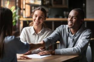 Happy interracial couple handshake