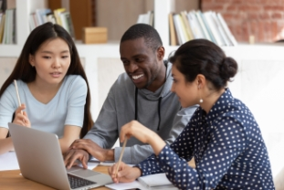 Smiling diverse students talk working